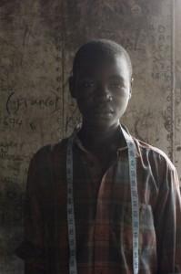 Eberhard Riedel Boy with Tape Measure, Kampala, Uganda, 2007 Archival Inkjet Print