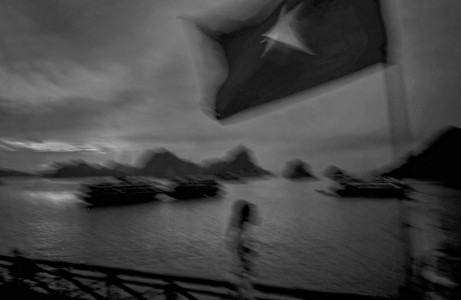 Kevin German /  LUCEO, A tourist boat flies the Vietnamese Communist flag in Ha Long Bay.
