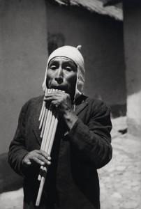 """Musician playing """"Zampona""""; Puno, 1925."""