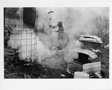 Beverly Conley, AR Woman Plucking a Chicken, 2003 Gelatin Silver Print