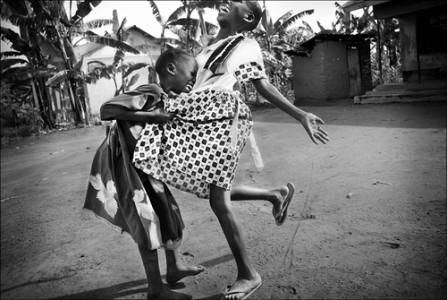 Girls Laughing, Rakai Village, Uganda, 2008 Archival Pigment Print © Leslie Alsheimer