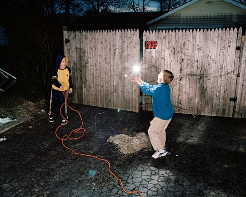 Untitled (boys throwing light bulb), 2008 Archival Pigment Print © Bradley Peters