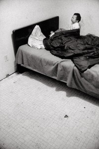 Abandonned Baby After the Adults Went Drinking, 1990 Selenium Toned Silver Bromide Print © Peter Sibbald