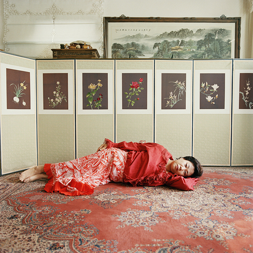 4.Woi Ja and the flower screen, Edition 1/5, 2007 Digital C-Print © Ok Hyun Ahn